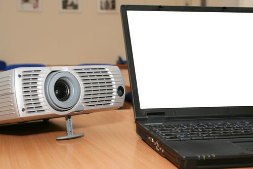 How The Pros Do It: Avoiding Embarrassment & Delivering Perfect Presentations laptop and projector