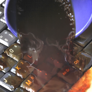 You Just Spilled Water Or Coffee On Your Laptop – Here's What You Should Do