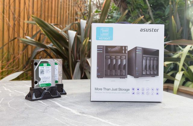 asustor as7004t nas - box and drives