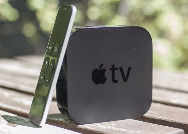 Apple TV and remote on table