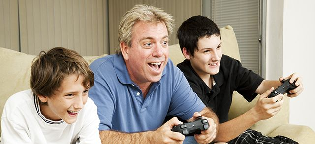 uncle plays video games with his nephews
