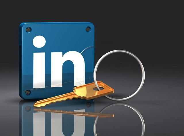 3d illustration of a large brass key lying in front of an upright blue LinkedIn logo with rivets