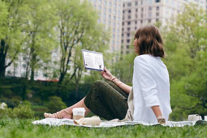 Woman Reading on a Samsung Tablet
