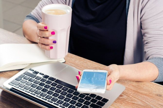 Woman Drinking Coffee on Phone and Mac