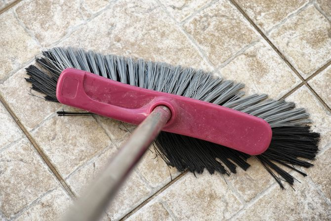 Broom Cleaning Stone Floor