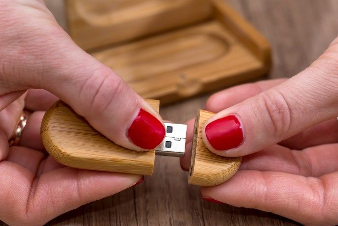 Wooden USB Opened With Hands