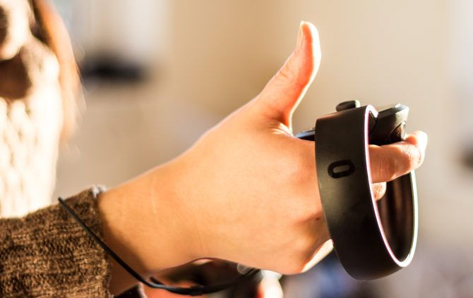 Oculus Touch VR Controllers Review Oculus Touch controllers thumbs up 670x423