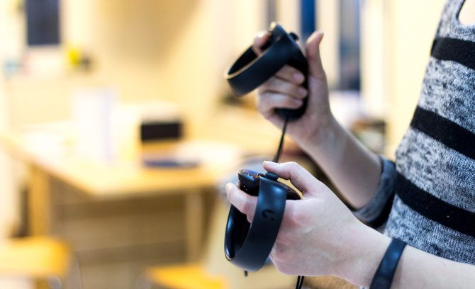 Oculus Touch VR Controllers Review Oculus Touch controllers using 2 670x408