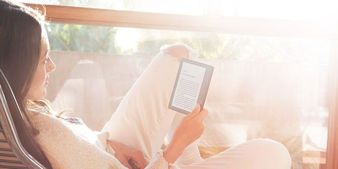 11 Tech Purchases You Won't Regret Making woman reading kindle oasis