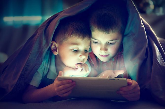 The Best Tools for Limiting Your Kids Online Screen Time KidsTabletNight shutterstock 407017621