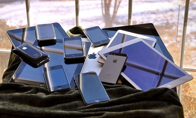pile of smartphones and tablets
