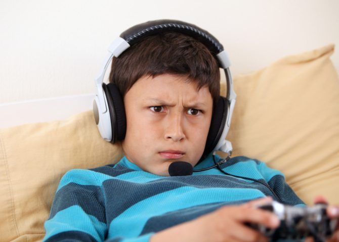 kid playing game with headset