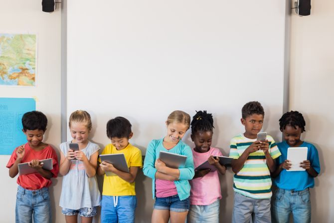 children holding tablets