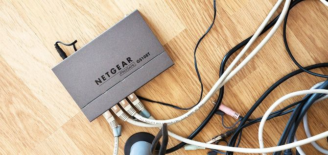 5 Reasons to Enable Quality of Service Settings on Your Router netgear router ethernet clutter