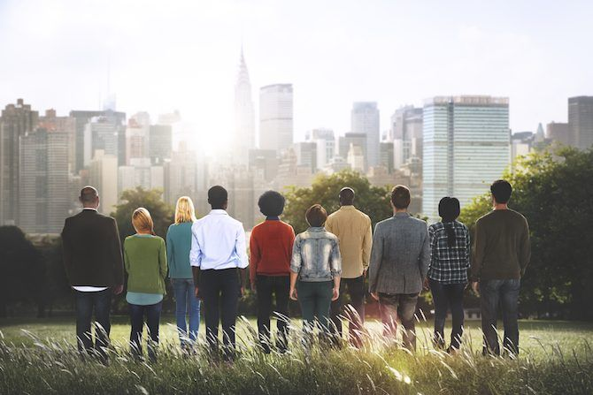 diverse group of people looking at the city