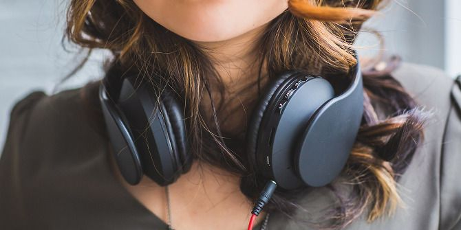 Here's Why Your Headphones Keep Breaking (And What You Can Do) headphones around neck