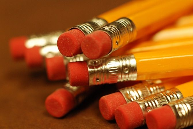 stack of pencils and erasers