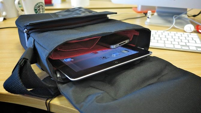 tablet sticking out of open bag