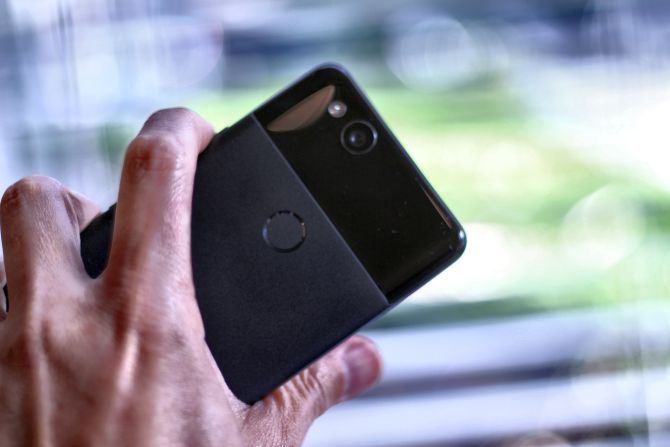 Google Pixel 2 Review: Is This The Best Smartphone Ever? google pixel 2 holding in hand 670x447
