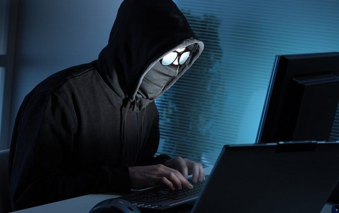 anonymous hacker on laptop