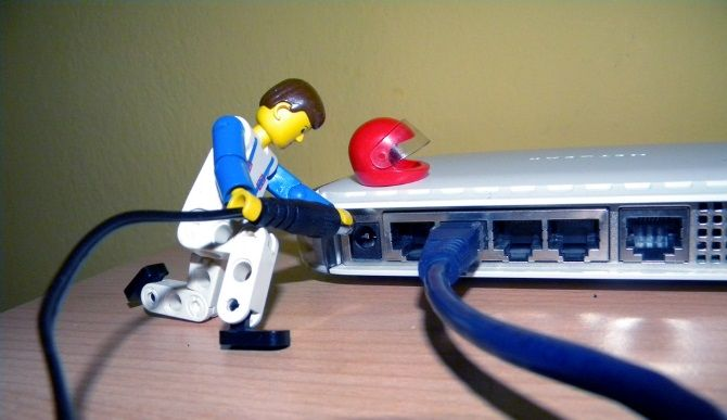 LEGO man working on router