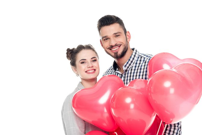 Man and woman with Valentine's Day balloons