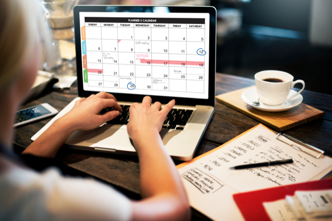 Woman scheduling tasks in her calendar