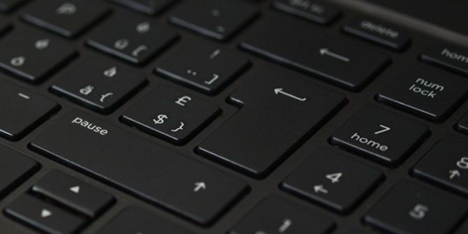 What Is a Shortcut Virus and How Can You Remove It? computer laptop keyboard close