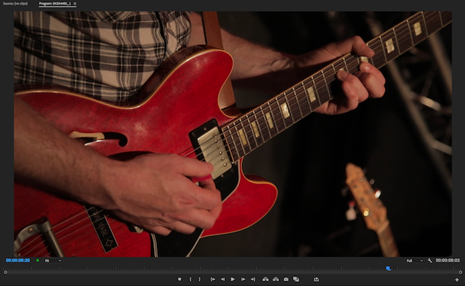 Person playing guitar, before color correction