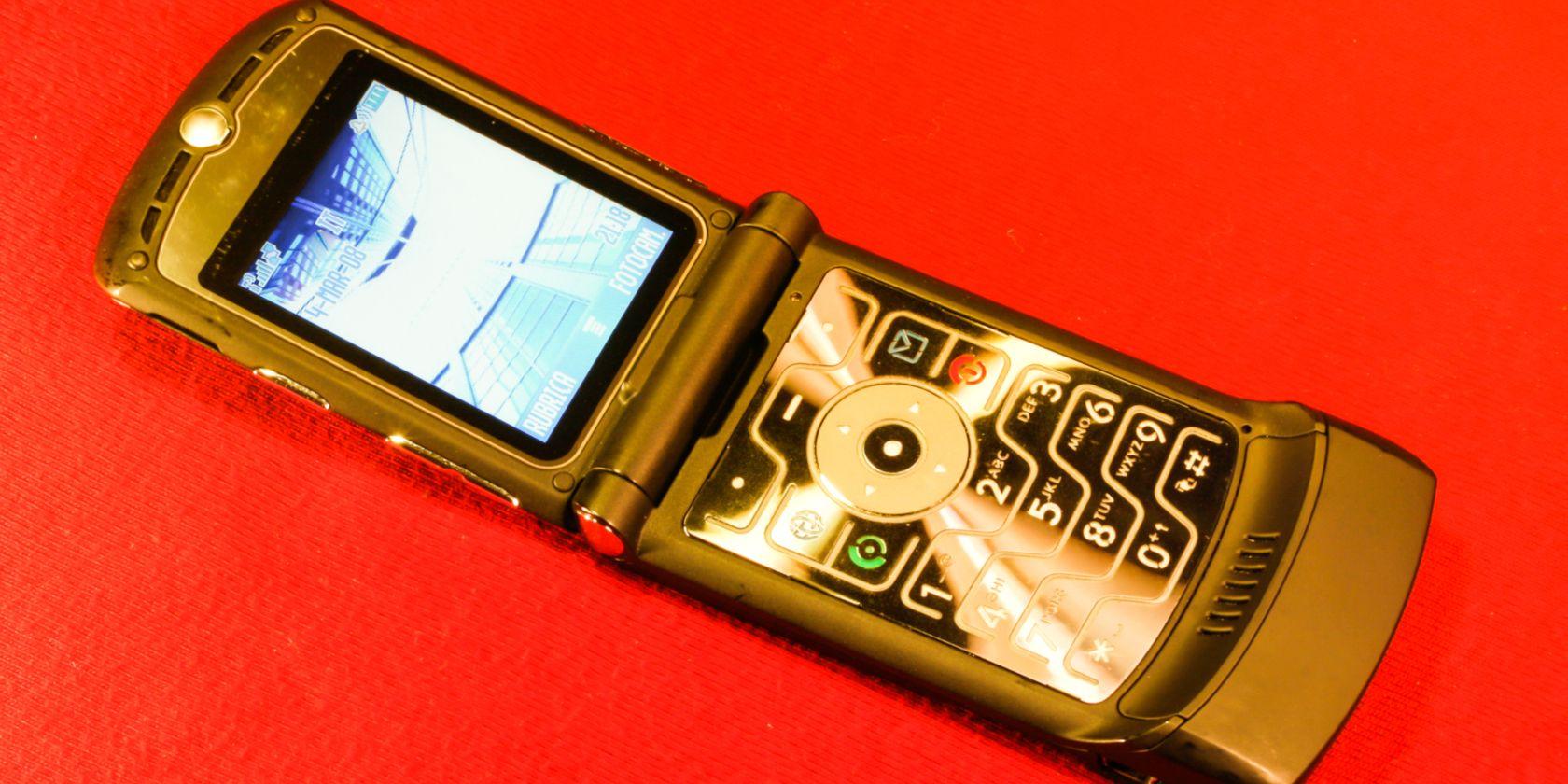 A motorola Razr phone on a red background
