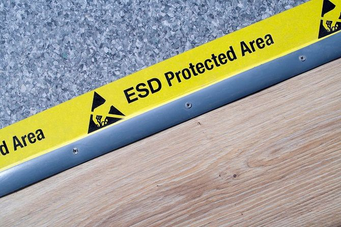 Flooring with ESD Protected Area tape running across it.