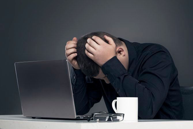 Man depressed with computer