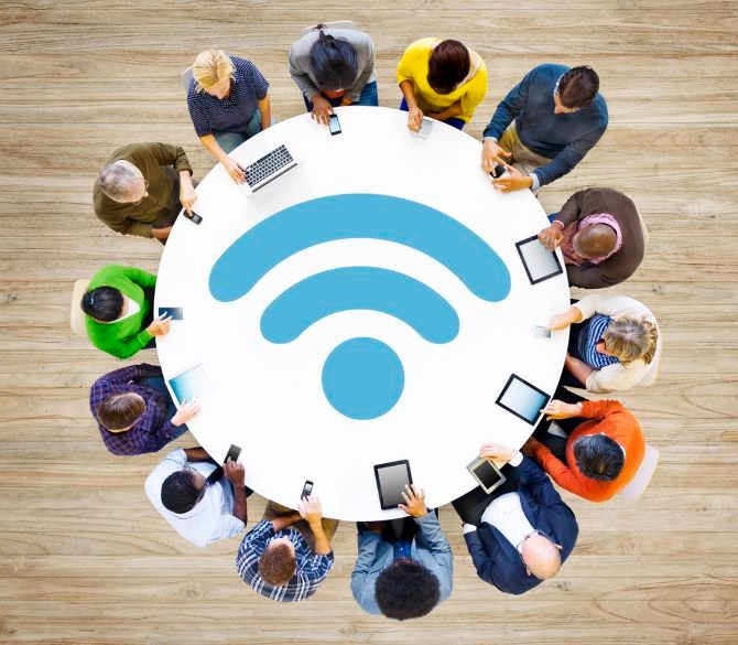 A group of people sharing a Wi-Fi connection