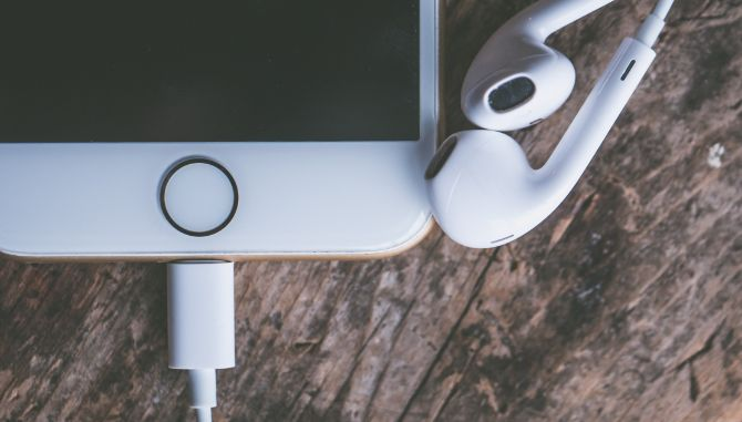 Apple EarPods plugged into Lightning port on iPhone