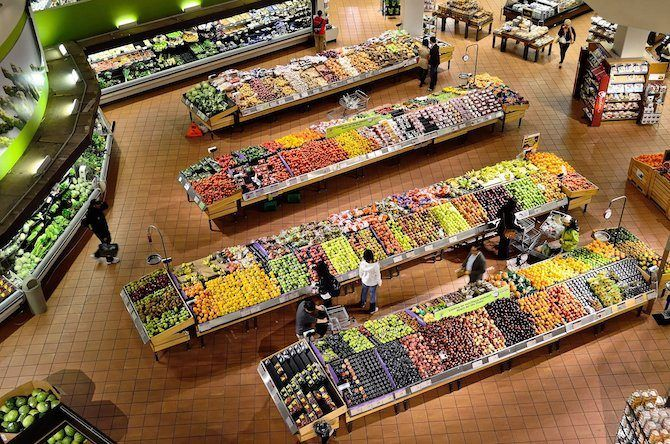 Grocery store fresh fruit and veg stalls